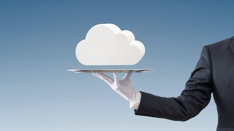 Businessman offering white cloud on silver tray over blue background