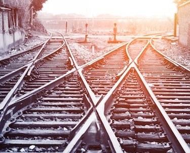 Two railroad tracks splitting off into distance
