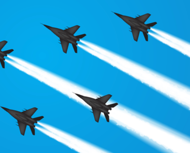 Fighter airplanes flying through blue sky