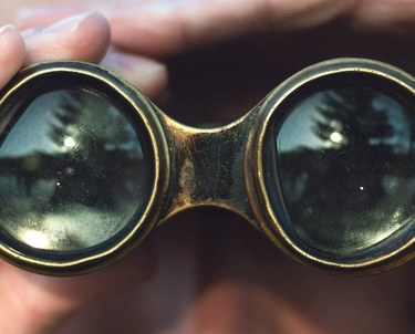 Man looking through binoculars